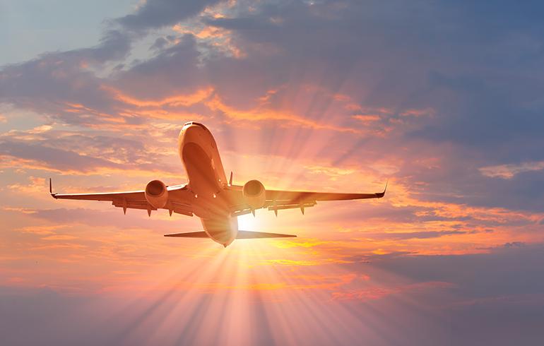 Airborne Plane amidst sunset.