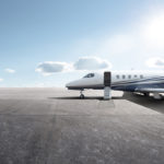 Business jet parked on runway during COVID-19