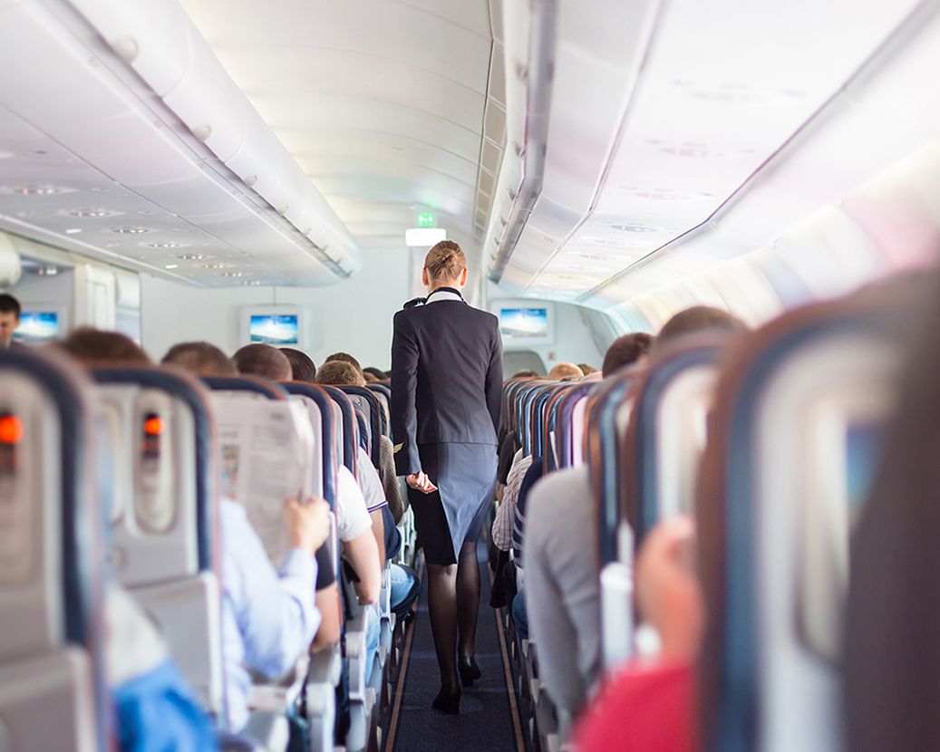 cabin aisle with flight attendant