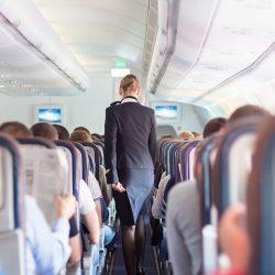 flight attendant in aisle
