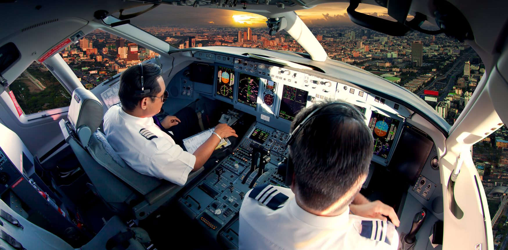 commercial jet cockpit with two pilots
