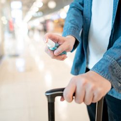 hand sannitizer being used by airline passenger