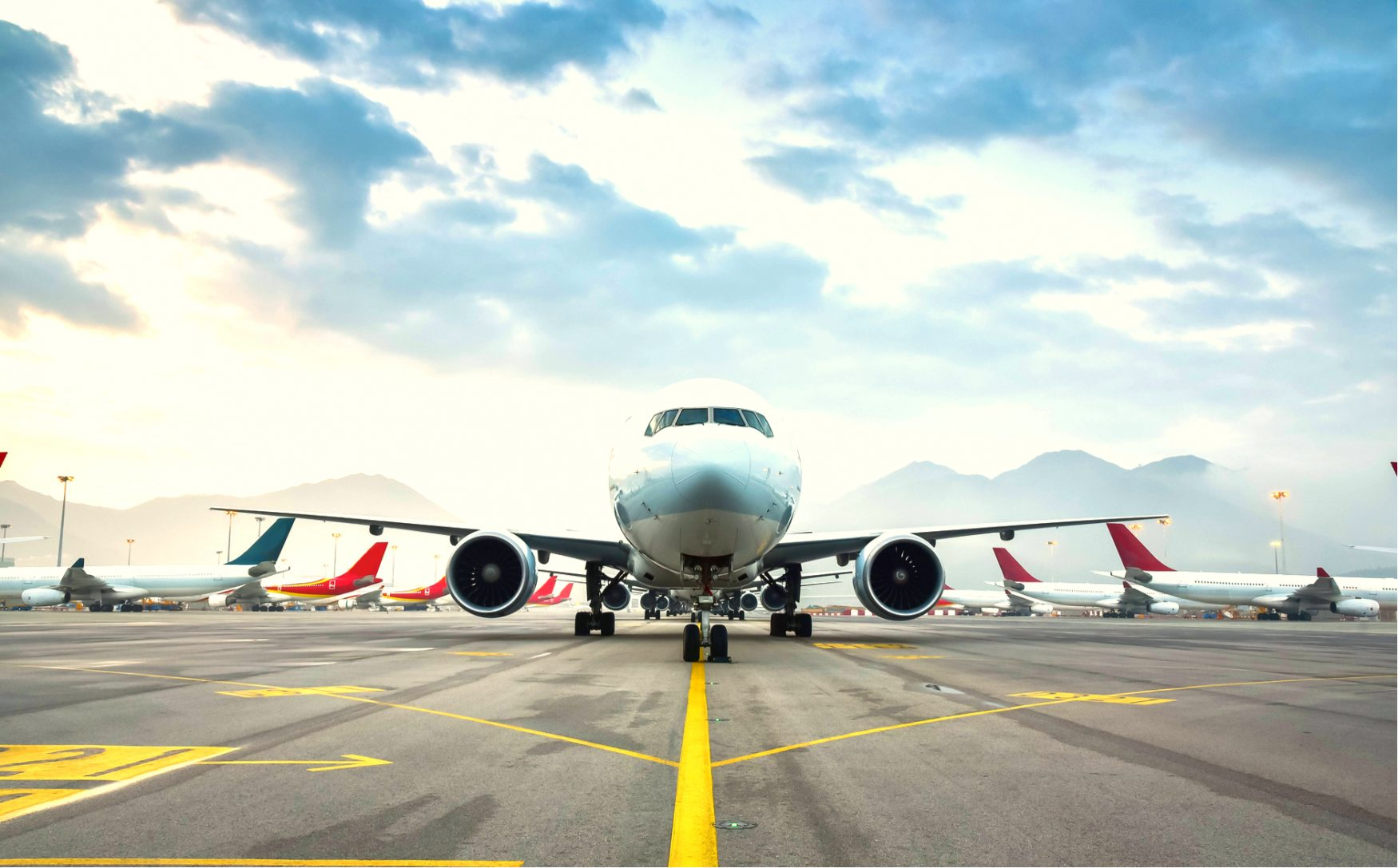 Airplane on runway with fleet