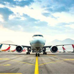 Airplane on runway with fleet