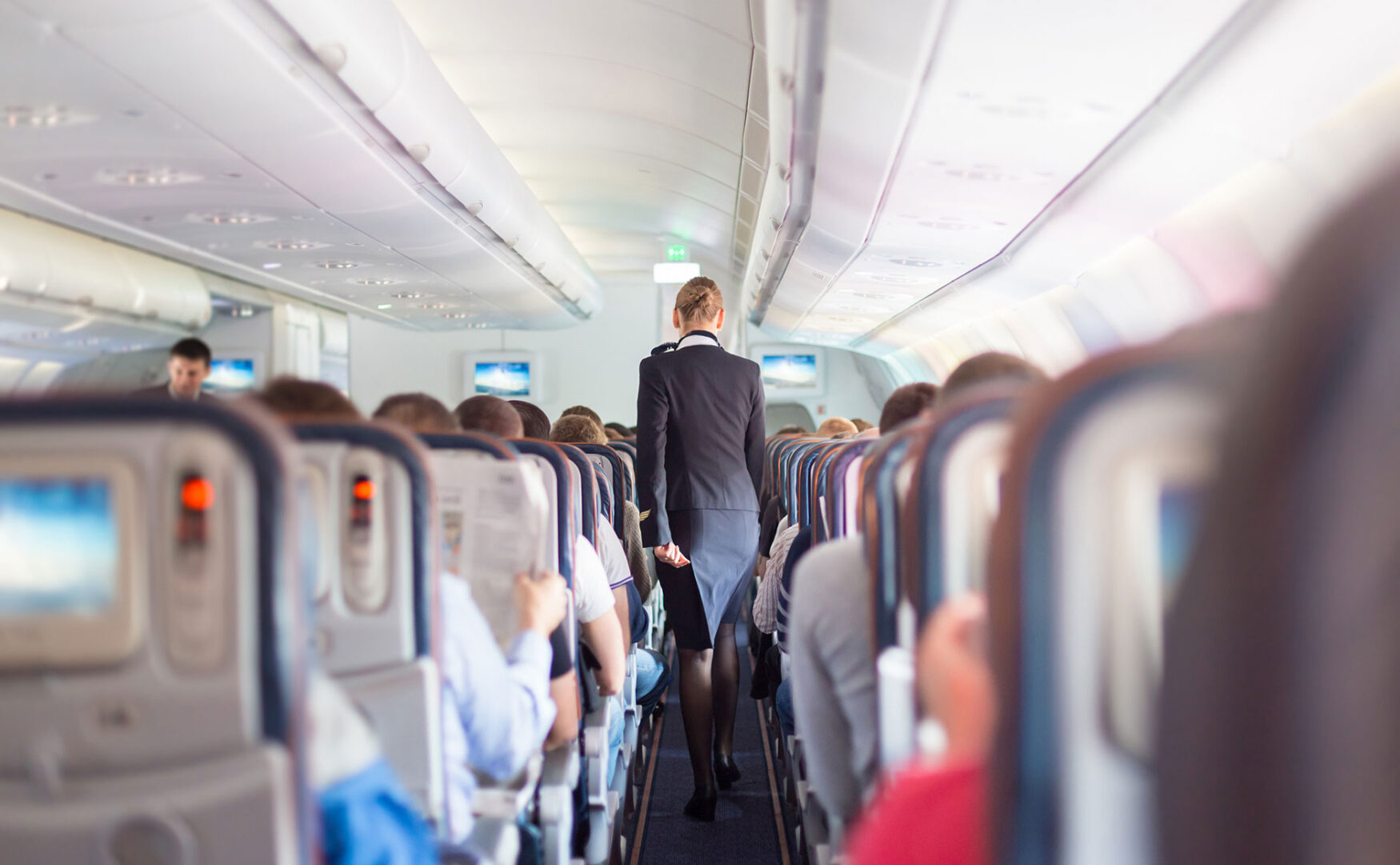 2-aisle airplane with flight attendant
