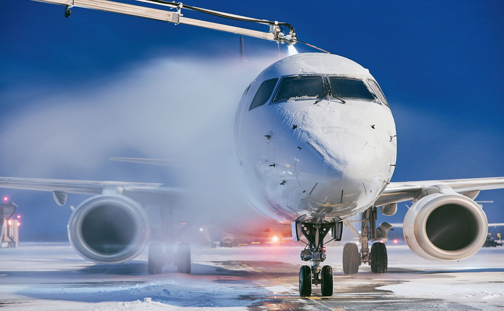 de-icing a plane on the tarmac