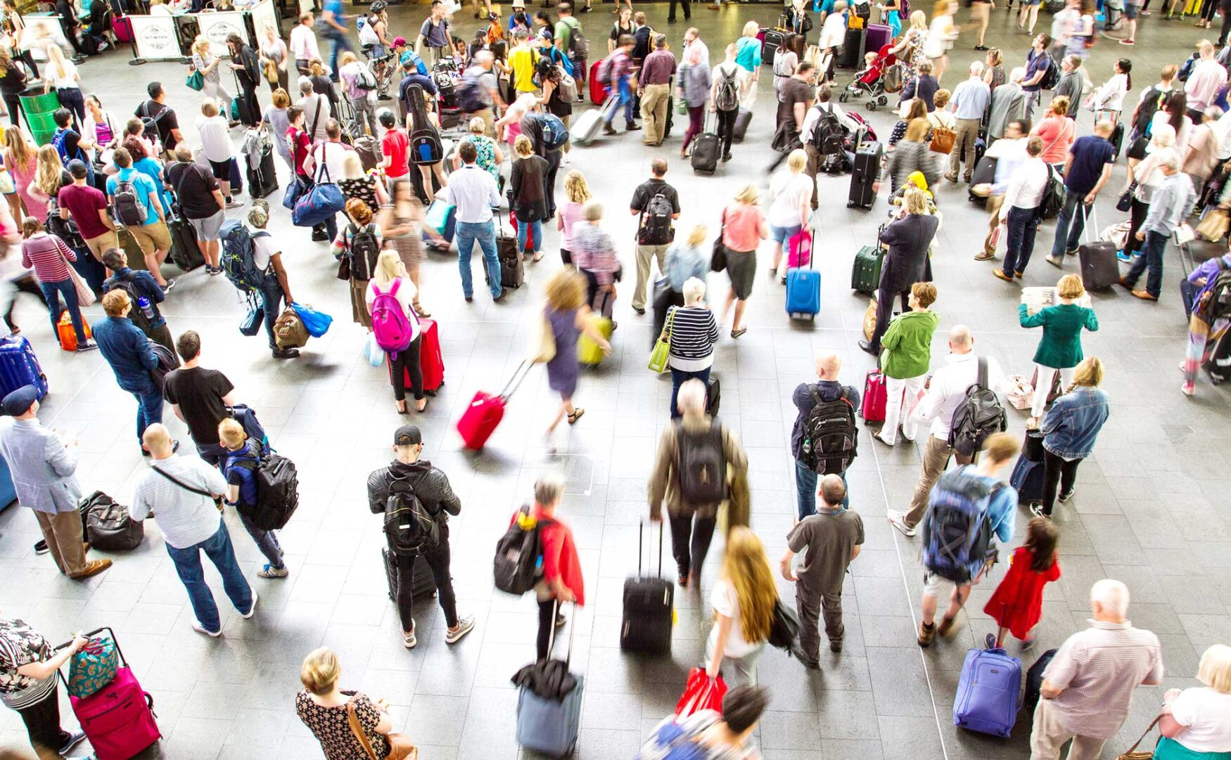 travelers in busy airport concourse