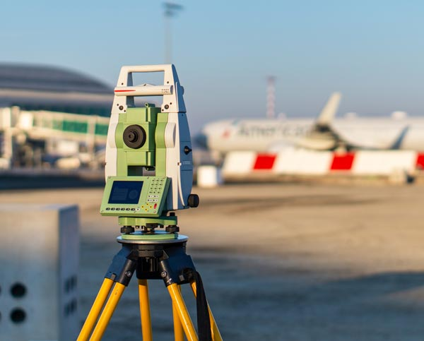 Airport infrastructure upgrade planning with tarmac survey equipment.