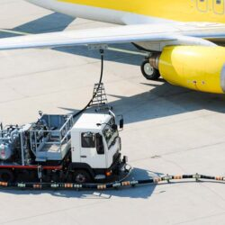Airplane refueling with truck on tramac.